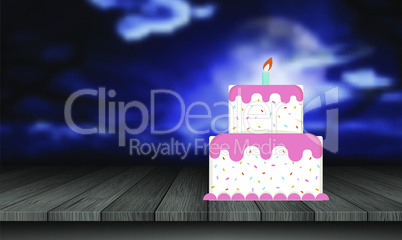 birthday cake is placed on the table at night
