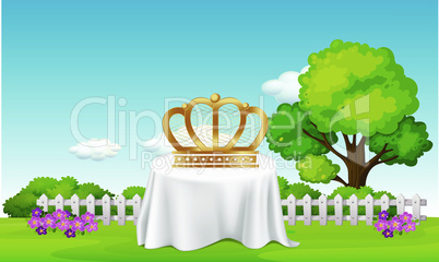 Crown is placed on a table in the garden