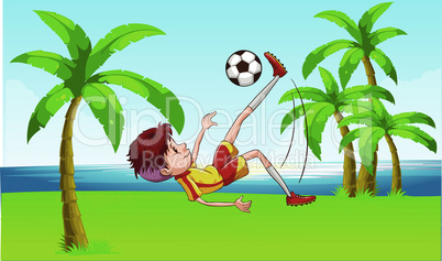 boy playing football on beach garden