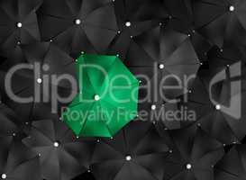 Concept image with lots of black umbrellas and a green umbrella