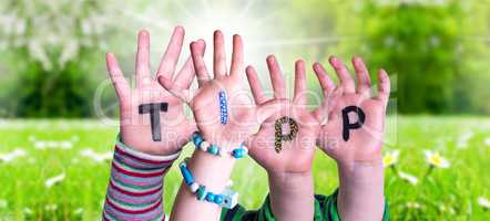 Children Hands Building Word Tipp Means Tip, Grass Meadow