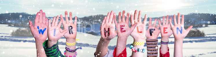 Kids Hands Holding Word Wir Helfen Means We Help, Snowy Winter Background