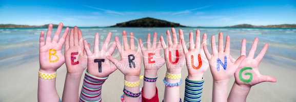 Kids Hands Holding Word Betreuung Means Day Care, Ocean Background