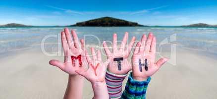 Kids Hands Holding Word Myth, Ocean Background