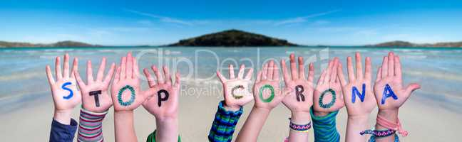 Children Hands Building Word Stop Corona, Ocean Background