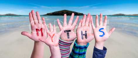 Kids Hands Holding Word Myths, Ocean Background