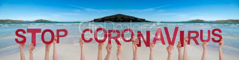 People Hands Holding Word Stop Coronavirus, Ocean Background
