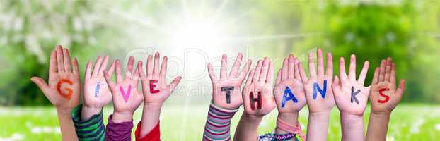 Children Hands Building Word Give Thanks, Grass Meadow