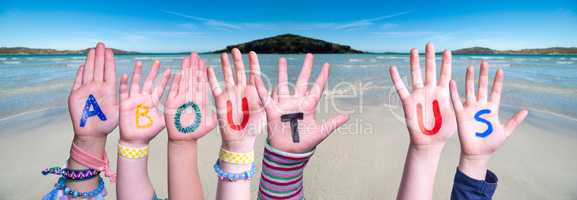 Children Hands Building Word About Us, Ocean Background