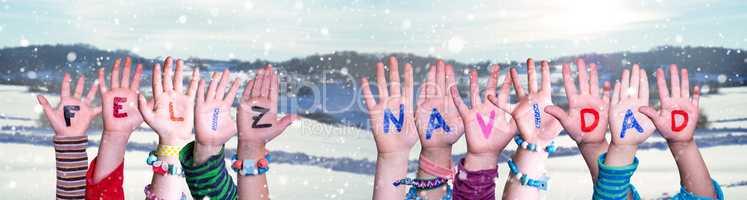 Children Hands Building Feliz Navidad Means Merry Christmas, Winter Background