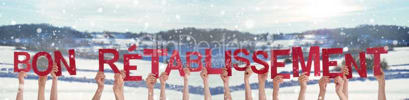 People Hands Holding Bon Retablissement Means Get Well Soon, Snowy Background