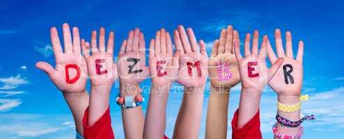 Children Hands Building Word Dezember Means December, Blue Sky