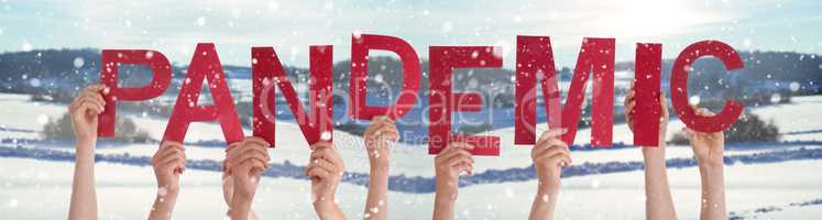 People Hands Holding Word Pandemic, Snowy Winter Background