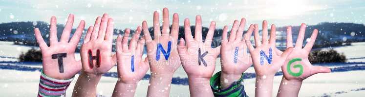 Children Hands Building Word Thinking, Snowy Winter Background