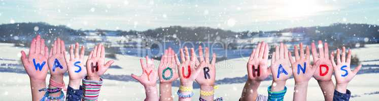 Kids Hands Holding Word Wash Your Hands, Snowy Winter Background
