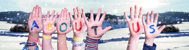 Children Hands Building Word About Us, Snowy Winter Background