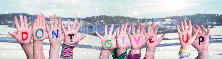 Kids Hands Holding Word Do Not Give Up, Snowy Winter Background