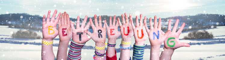 Kids Hands Holding Word Betreuung Means Day Care, Snowy Winter Background
