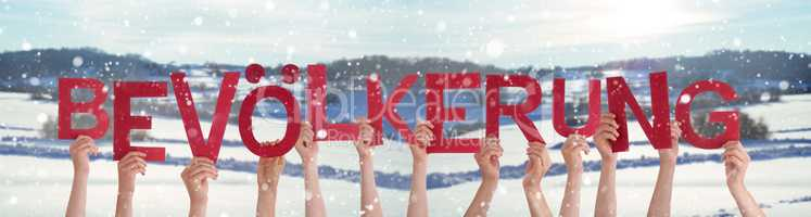 People Hands Holding Word Bevoelkerung Means Population, Snowy Winter Background