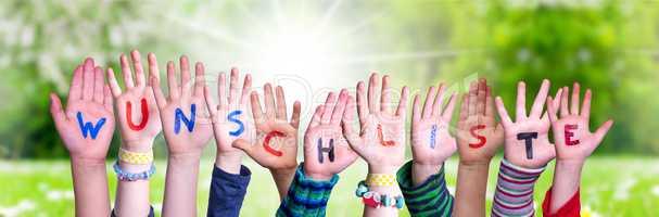 Children Hands Building Word Wunschliste Means Wishlist, Grass Meadow