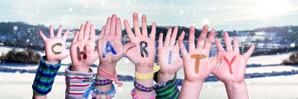 Children Hands Building Word Charity, Snowy Winter Background