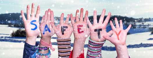 Children Hands Building Word Safety, Snowy Winter Background