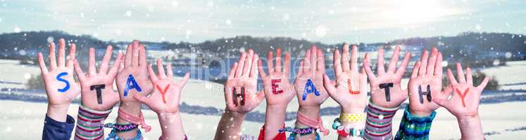 Kids Hands Holding Word Stay Healthy, Snowy Winter Background