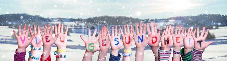Kids Hands Holding Word Viel Gesundheit Means Stay Healthy, Snowy Winter Background