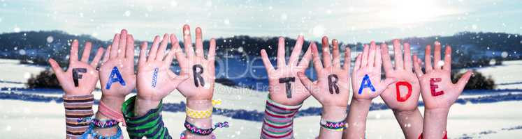 Children Hands Building Word Fair Trade, Snowy Winter Background