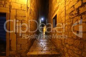 Narrow streets of Sibenik, old town in Croatia in the evening