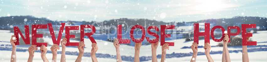 People Hands Holding Word Never Lose Hope, Snowy Winter Background