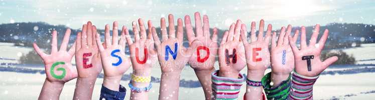 Kids Hands Holding Word Gesundheit Means Health, Snowy Winter Background