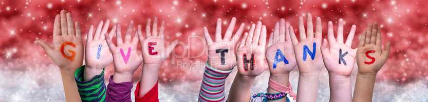 Children Hands Building Word Give Thanks, Red Christmas Background