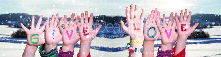 Children Hands Building Word Give Love, Snowy Winter Background