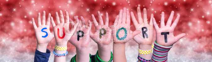 Children Hands Building Word Support, Red Christmas Background