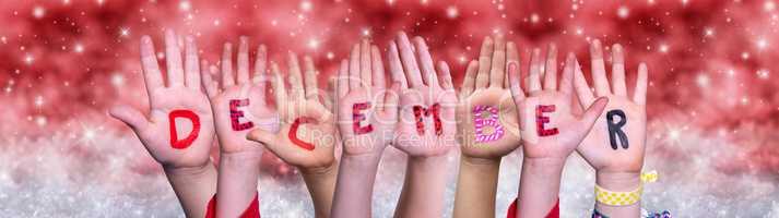 Children Hands Building Word December, Red Christmas Background