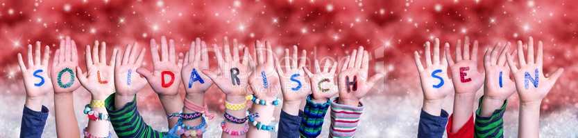 Children Hands Solidarisch Sein Means Solidarity, Red Christmas Background