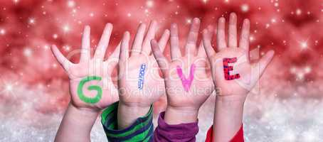 Children Hands Building Word Give, Red Christmas Background