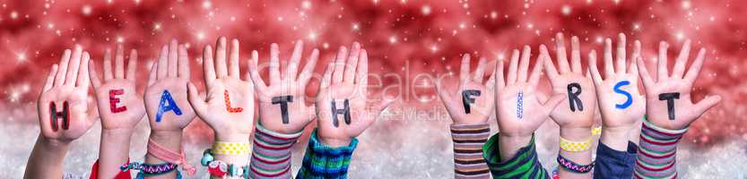 Children Hands Building Word Health First, Red Christmas Background