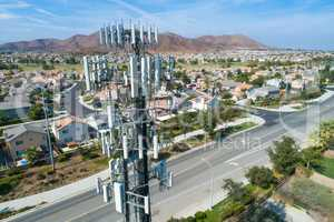 Close-up Aerial of Cellular Wireless Mobile Data Tower with Neig
